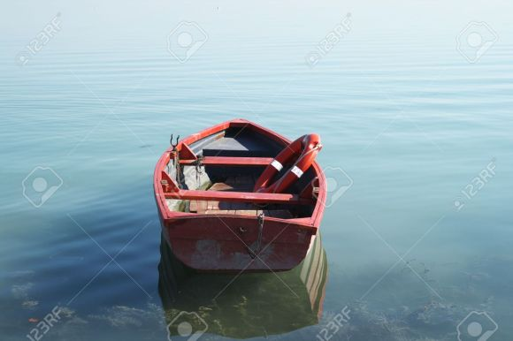 7001751-He-is-a-lifeboat-on-an-empty-beach--Stock-Photo